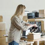 Woman prpeparing for pre-move garage sale