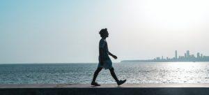Man walking on the beach.