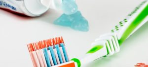 toothpaste and toothbrush as a part of packing moving essentials bag guide