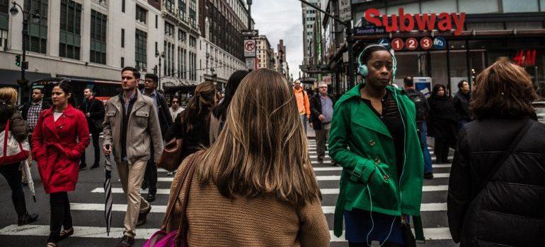 people walking - leave Manhattan in 2021