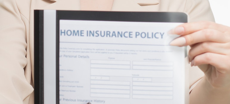a person holding insurance papper