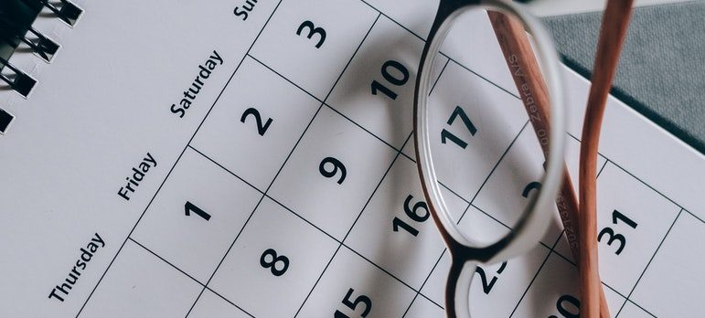 framed glasses and a calendar