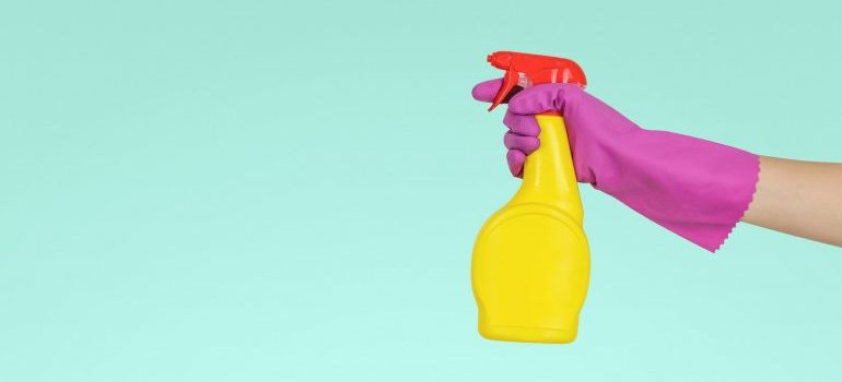 a hand holding a cleaning product